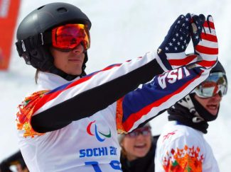 Evan Strong of United States celebrates his victory in the men's para snowboard cross, standing event at the 2014 Winter Paralympic  March 14 in Krasnaya Polyana, Russia.