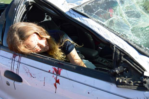 A student, covered in fake blood, portrays the victim of a mock collision Wednesday morning at Nevada Union High School as part of the Every 15 Minutes program.