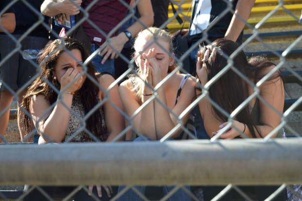 Students react to the scene of mock collision as part of the Every 15 Minutes program at Nevada Union High School Wednesday.