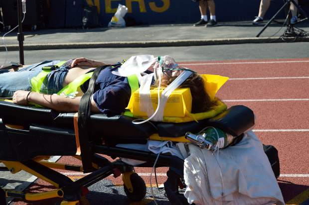 A student portraying someone injured in mock collision is carried on a gurney during the Every 15 Minutes program at Nevada Union High School Wednesday.