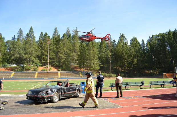 A helicopter lands at the scene of a mock collision Wednesday morning as part of the Every 15 Minutes program at Nevada Union High School.