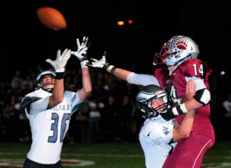 Colfax defenders break up a pass attempt to Bear River's Kris Edie.