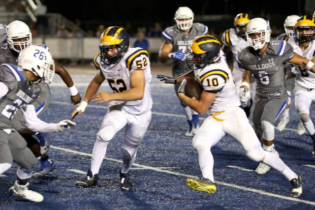 Nevada Union's Kase Scott runs the ball during a game against Folsom Oct. 9.