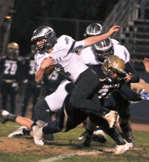 Colfax's Tim Rawlins runs upfield with the football during a Sac-Joaquin D-IV playoff game versus Central Catholic last season. Rawlings impressed as a junior and will carry the load as a senior.