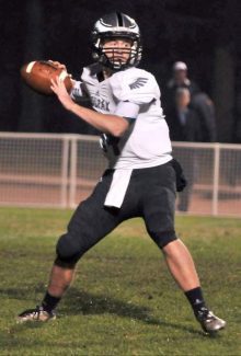 Colfax's senior quarterback Michael Wilson looks to pass during a Sac-Joaquin D-IV playoff game versus Central Catholic earlier this season. Wilson was recently named the male CIF/Farmer's Scholar-Athlete of the Year