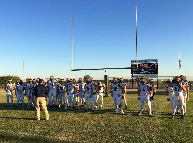Nevada Union players line up before the game against Pioneer Friday in Woodland.