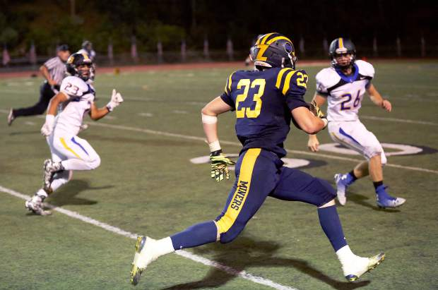 Nevada Union's Owen Day runs the ball against Lincoln Friday night.