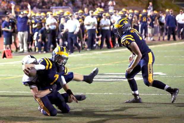 Nevada Union's Owen Dal Bon reaches for a touchdown during a game against Napa at Hooper Stadium Friday night.