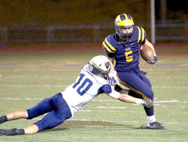 Nevada Union's Tyler Nielson runs the ball during a game against Napa at Hooper Stadium Friday night.