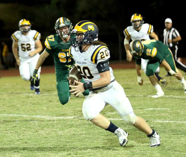 Nevada Union's Justin Houlihan runs the ball during a game against Placer at Le Febvre Stadium Friday night.