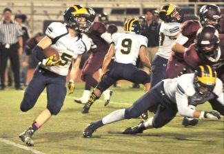 Nevada Union's Travis Owens looks for an opening during a game against Woodcreek last season.