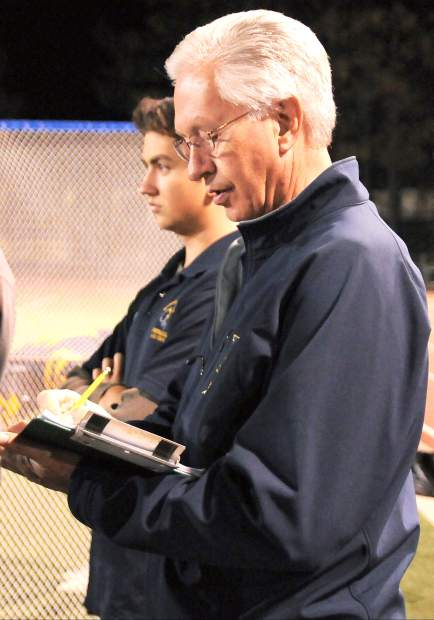 Andy Owens, right, with his grandson Tristan Moore look on at a Nevada Union football game. Owens has been the NU football statistician and team chaplain for the past 35 years, but will walk away from the program after this season.