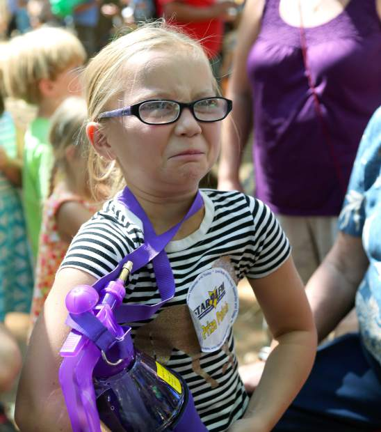 Kids eat grasshoppers and crickets at the Nevada County Fair on Wednesday.