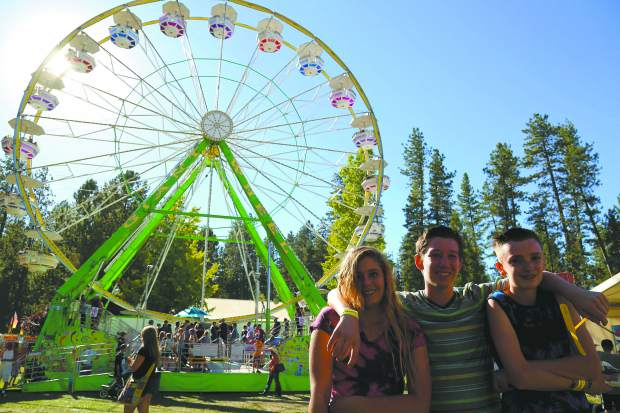 Dana Fourniur, left, Bennett King, and Drew Laferriere enjoy opening day of the Nevada County Fair at the fairgrounds on Wednesday.