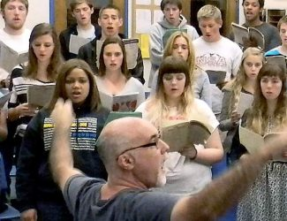 The Nevada Union High School Choir, pictured here at rehearsel, will perform Tuesday evening at Margarita's in Grass Valley in a benefit for their upcoming trip to Southern California.