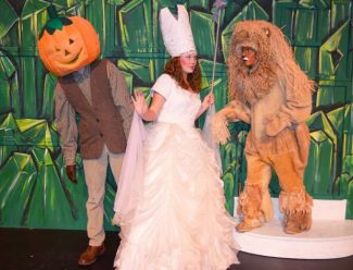"""From  left  Jack Pumpkinhead played by Nathaniel Dani, Glinda played by Madeline Gardiner,and the Lion played by Anna Morton, all star in the Performing Arts Guild fall musical """"The Lost Princess of Oz,"""" that opens today at the Center for the Arts."""