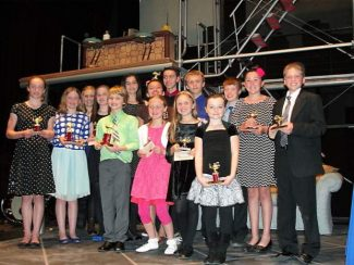 Fifteen finalists in the 2014 Nevada County Speech Tournament, celebrating its 30th anniversary year, pose for a photo with their trophies Tuesday night at the Nevada Theatre in Nevada City.