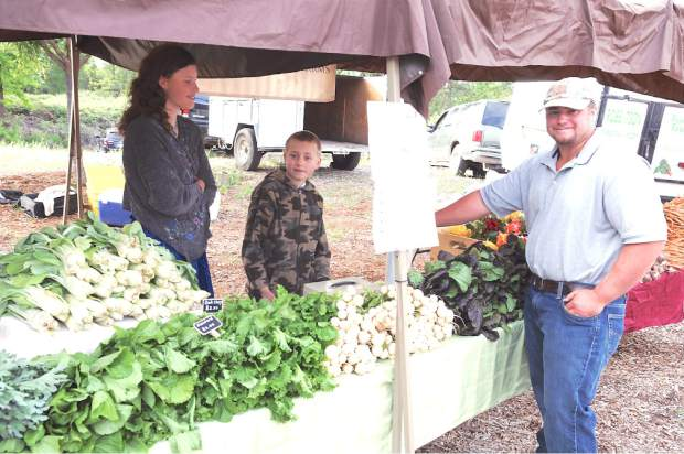 Callia, Johnny and Cody Johnson display their harvest from the Johnson Family Farm in Nevada City at the first Certified Growers Market  held Saturday morning at the North Star House, Auburn Road in Grass Valley.