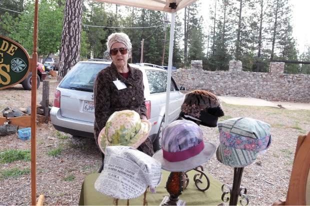 Linda Gunderson of Grass Valley sells homemade women and kids hats at the first Nevada County Certified Growers Market in North Star House, Auburn Road in Grass Valley.