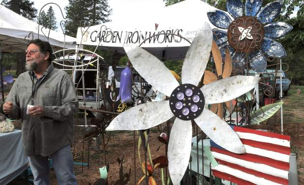 Jerry LaFerriere of Garden Iron Works, Nevada City, sells garden ornaments made out of recycled materials at the first Nevada County Certified Growers Market in North Star House, Auburn Road in Grass Valley.