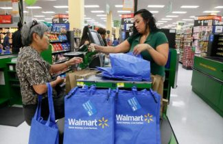 Consumers shop at the new Walmart Neighborhood Market, opening its 34,000 square foot store in the Chinatown district  of Los Angeles Thursday, Sept. 19, 2013. (AP Photo/Nick Ut)