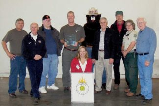 The Greater Alta Sierra Firewise Committee with event dignitaries (from left):  Pete Santiago; Nevada County Consolidated Fire Chief, David Ray; Rich Bergstedt; Chairman Peter Beesley; Fire Safe Council Executive Director, Joanne Drummond; Smokey Bear; Nevada County Supervisor, Ed Scofield; Gary Combes; US Forest Service, Liz Kurpies; and Alta Sierra Property Owners Association Vice President, Lee French.