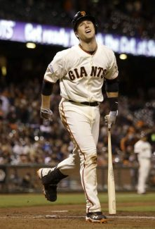 San Francisco Giants' Buster Posey reacts after striking out during the thirteenth inning of a baseball game against the New York Mets in San Francisco, Monday, July 8, 2013. The Mets won 4-3 in 16 innings. (AP Photo/Jeff Chiu)