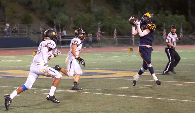 A Nevada Union reciever gets a catch Friday night against the Lincoln Fighting Zebras.