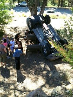 A woman was driving a Jeep that ran over a retaining wall and fell 10 feet Friday afternoon.