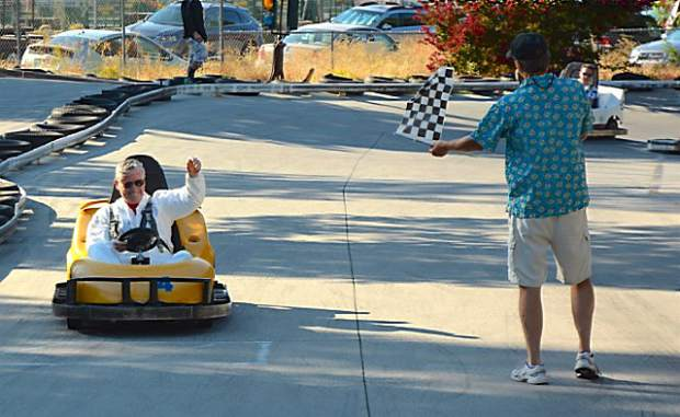 David Jones takes the checkered flag during his go-kart heat race of the Friendship 100 Monday at 49er Fun Park in Grass Valley.