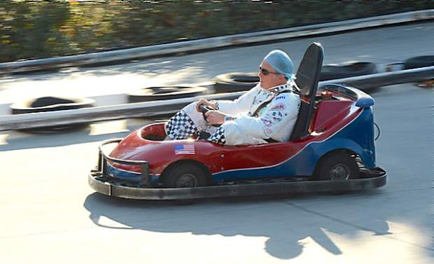 Dr. Rob Avery races through a lap during Monday's Friendship 100 go-kart races, which raise funds for the Friendship Club and its programs supporting at-risk girls in the community.