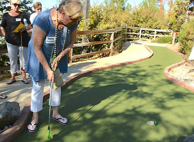 Sharon Pusateri's putt lips out of the hole during the miniature golf tournament at the Friendship Club's Friendship 100 Monday at 49er Fun Park in Grass Valley.