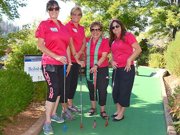 Teresia Renwick, left, Lonna Morrissey, Carol Scofield and Maggie Rossovich competed as a team during Monday's Friendship 100 miniature golf tournament at 49er Fun Park in Grass Valley.