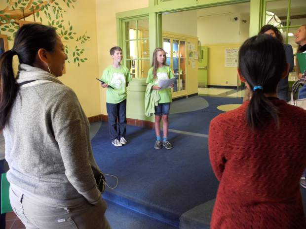 Seventh-grader Douglas Briney and sixth-grader Rowan Muir stand in Grass Valley Charter School's entryway, preparing to lead a tour of seminar participants through the school on Friday.