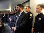 Grass Valley Police Officer Evan Butler, the recipient of the employee of the year award, stands with his colleagues at the Council Chambers before the Tuesday City Council meeting begins.