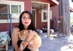 Selena DeLuna with her cat Jesse James at their home in Grass Valley, the potential site for a new hotel.