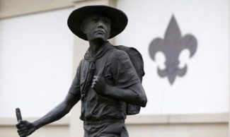 A statue of a Boy Scout stands in front of the National Scouting Museum, Monday, Jan. 28, 2013, in Irving, Texas. The Boy Scouts of America announced it is considering a dramatic retreat from its controversial policy of excluding gays as leaders and youth members. (AP Photo/LM Otero)