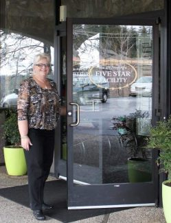 Golden Empire Nursing and Rehabiliation Center Administrator, Vicki Young, stands in front of the center which was named one of the best nrusing homes of 2014 by U.S. World and News Report.