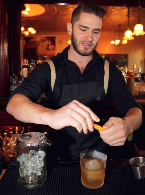 Golden Era bartender Zach Morgan makes one of their signature cocktails, Whittemore's Last Call. The new bar opens today 4pm in downtown Nevada City.