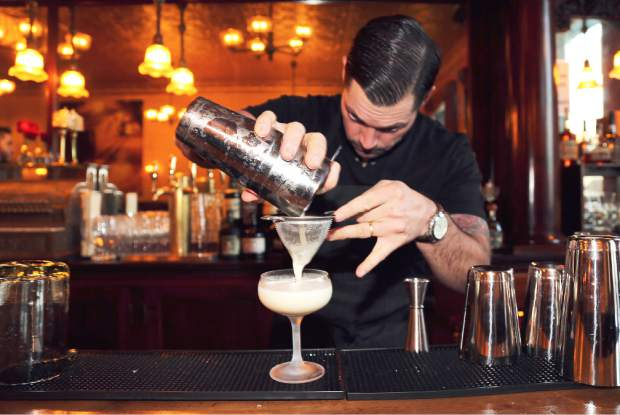 Golden Era bar manager Ben Smith makes one of their signature cocktails, Gold Rush Sour. The new bar opens today 4pm in downtown Nevada City.