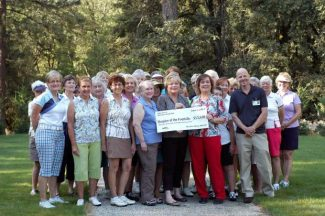 Members from Hospice in the Foothills accept a check for $13,600 from the Alta Sierra Women's Golf Club.