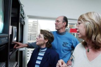 FILE — From left, NCTV station manager Frances Rau, NCTV executive director Lew Sitzer and NCTV station coordinator Terri Hicklin monitor the digital log at NCTV in April 2004.