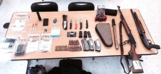 Shown are weapons recovered at a bust on May 30 at the Holiday Lodge. More weapons were discovered last week.