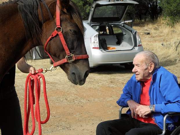 Ken Baker, 85, shared a tender moment with Rafael, a 12-year-old horse from Juarez, Mexico, during a visit to CAPE Animal Sanctuary, on Friday, Oct. 23.