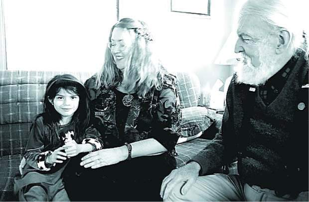 Ciela Hanson Kickinger, 6, visits Hospitality House with her mother, Savannah Hanson, center, in this December 2006 photo, and is greeted by Hospitality House board member Utah Phillips.