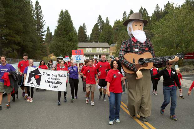 Hospitality House co-founder Utah Phillips leads the charge for the Long Walk, a fundraiser for Hospitality House Saturday morning.