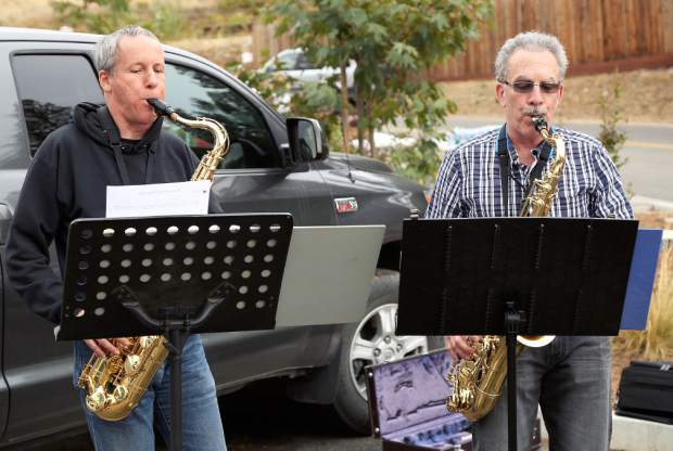 Blended Metal Saxophones perform during the Long Walk, a fundraiser for Hospitality House Saturday morning.