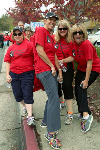 Participants walk 1.8 miles down Sutton Way and Brunswick Road for the Long Walk, a fundraiser for Hospitality House Saturday morning.