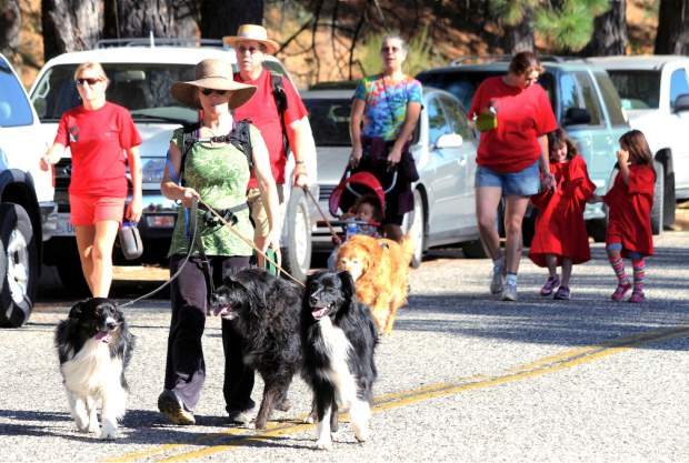 The Long Walk, a benefit for Hospitality House, starts at Utah's Place int his 2014 archive photo. People and their dogs on the walk.
