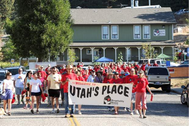 The Long Walk, a benefit for Hospitality House, starts at Utah's Place int his 2014 archive photo. Marybeth Paul and Nory Fussell carrying the banner and the walkers in back of them.